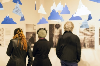 Opening night - visitors reading profiles of dreamers.